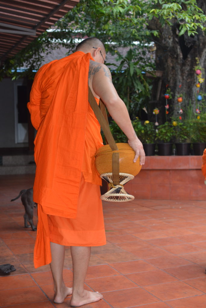 Monk-Getting-Ready-to-stepout-to-accept-offerings-from-people-on-the-street